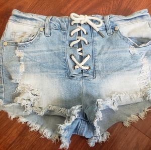 Frayed and distressed jean shorts
